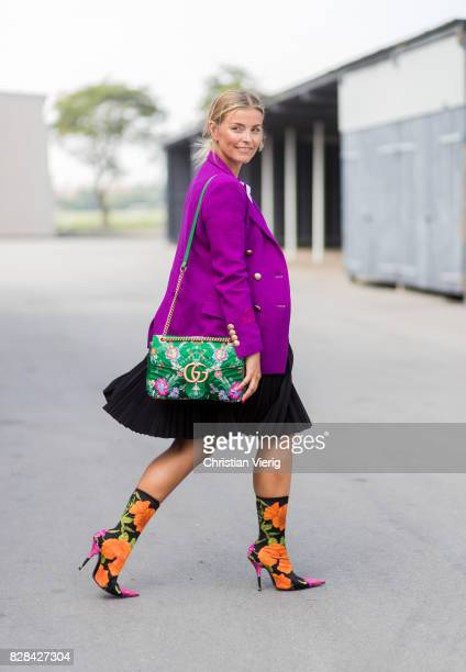 Janka Polliani wearing purple blazer Balenciaga boots Gucci bag outside By Malene Birger on August 09 2017 in Copenhagen Denmark