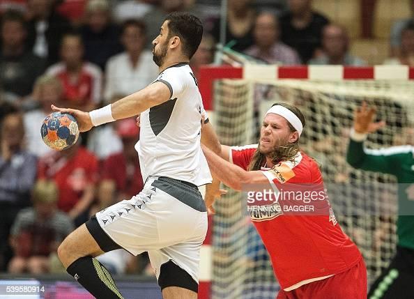 Janko Bozovic of Austria and Mikkel Hansen OF Denmark vie during their men's World Championship handball qualification match between Denmark and...