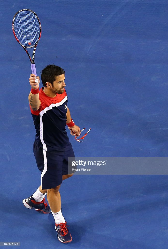 Janko Tipsarevic of Serbia celebrates after winning his first round match against Lleyton Hewitt of Australia during day one of the 2013 Australian Open at Melbourne Park on January 14, 2013 in Melbourne, Australia.