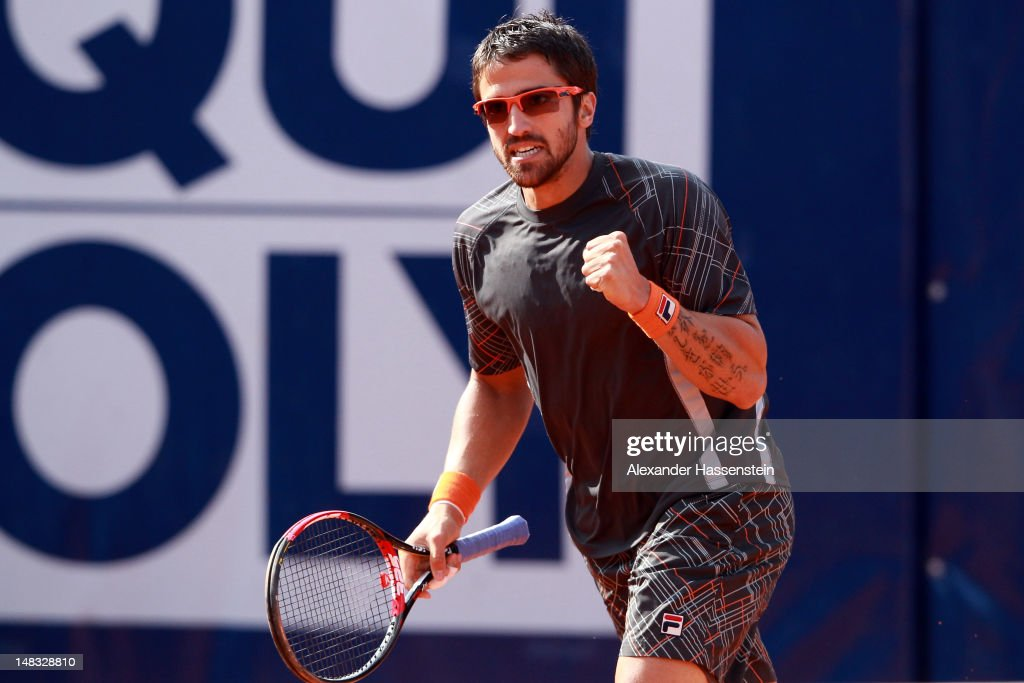 <a gi-track='captionPersonalityLinkClicked' href=/galleries/search?phrase=Janko+Tipsarevic&family=editorial&specificpeople=546505 ng-click='$event.stopPropagation()'>Janko Tipsarevic</a> of Serbia celebrates during his semi finale match against Thomaz Bellucci of Brazil during the Mercedes Cup 2012 at the TC Weissenhof on July 14, 2012 in Stuttgart, Germany.