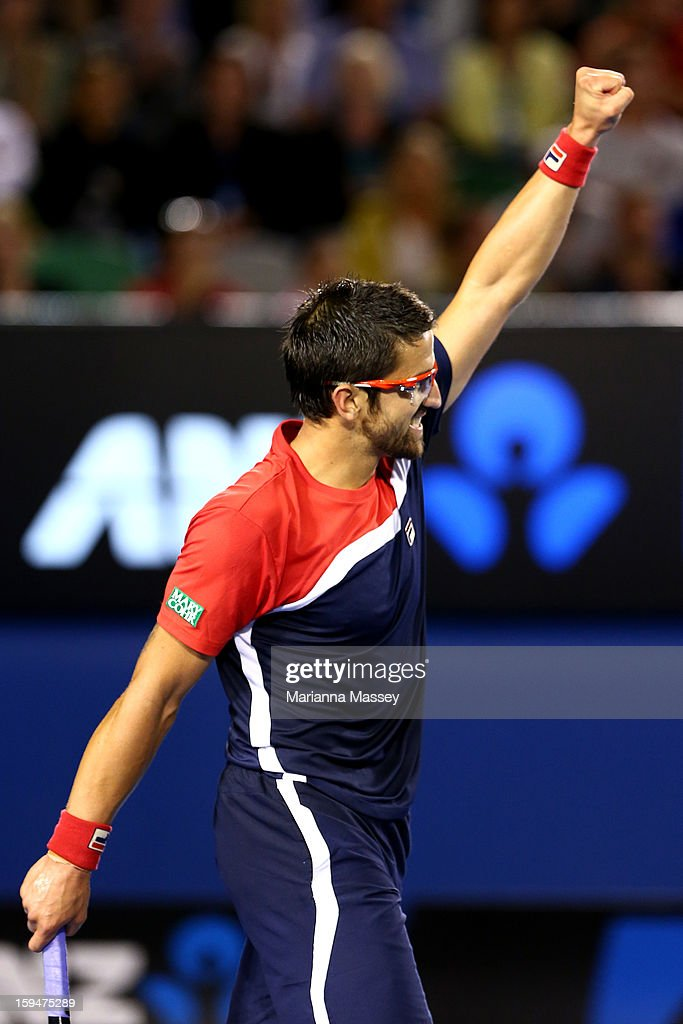 Janko Tipsarevic of Serbia celebrates in his first round match against Lleyton Hewitt of Australia during day one of the 2013 Australian Open at Melbourne Park on January 14, 2013 in Melbourne, Australia.