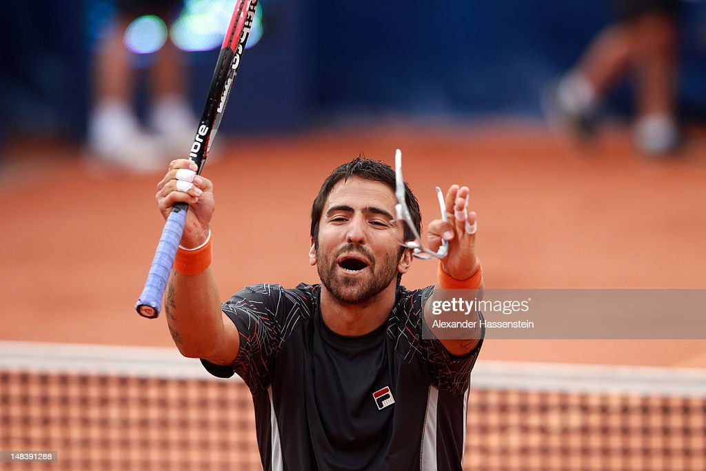 <a gi-track='captionPersonalityLinkClicked' href=/galleries/search?phrase=Janko+Tipsarevic&family=editorial&specificpeople=546505 ng-click='$event.stopPropagation()'>Janko Tipsarevic</a> of Serbia celebrates victory after winning his finale match against Juan Monaco of Argentinia during day 6 of Mercedes Cup 2012 at the TC Weissenhof on July 15, 2012 in Stuttgart, Germany.