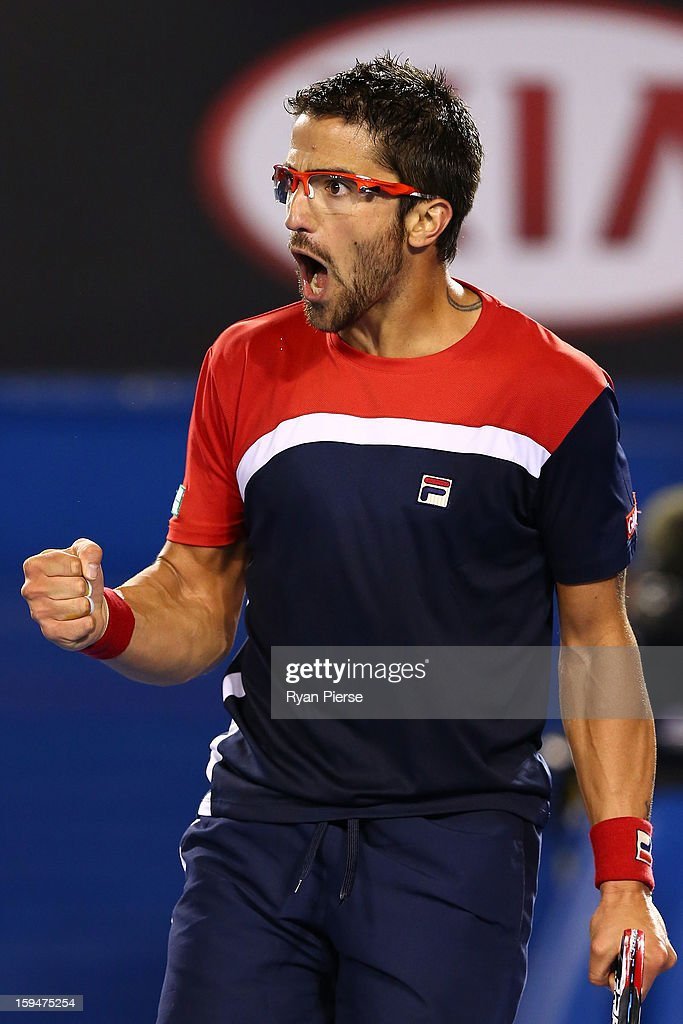 Janko Tipsarevic of Serbia celebrates winning a point in his first round match against Lleyton Hewitt of Australia during day one of the 2013 Australian Open at Melbourne Park on January 14, 2013 in Melbourne, Australia.