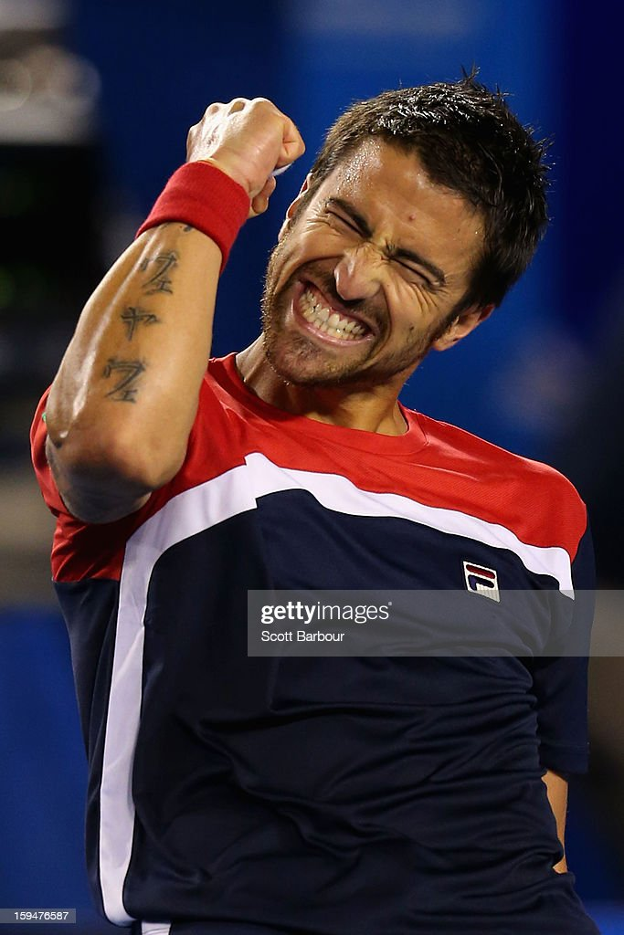 <a gi-track='captionPersonalityLinkClicked' href=/galleries/search?phrase=Janko+Tipsarevic&family=editorial&specificpeople=546505 ng-click='$event.stopPropagation()'>Janko Tipsarevic</a> of Serbia celebrates winning his first round match against Lleyton Hewitt of Australia during day one of the 2013 Australian Open at Melbourne Park on January 14, 2013 in Melbourne, Australia.