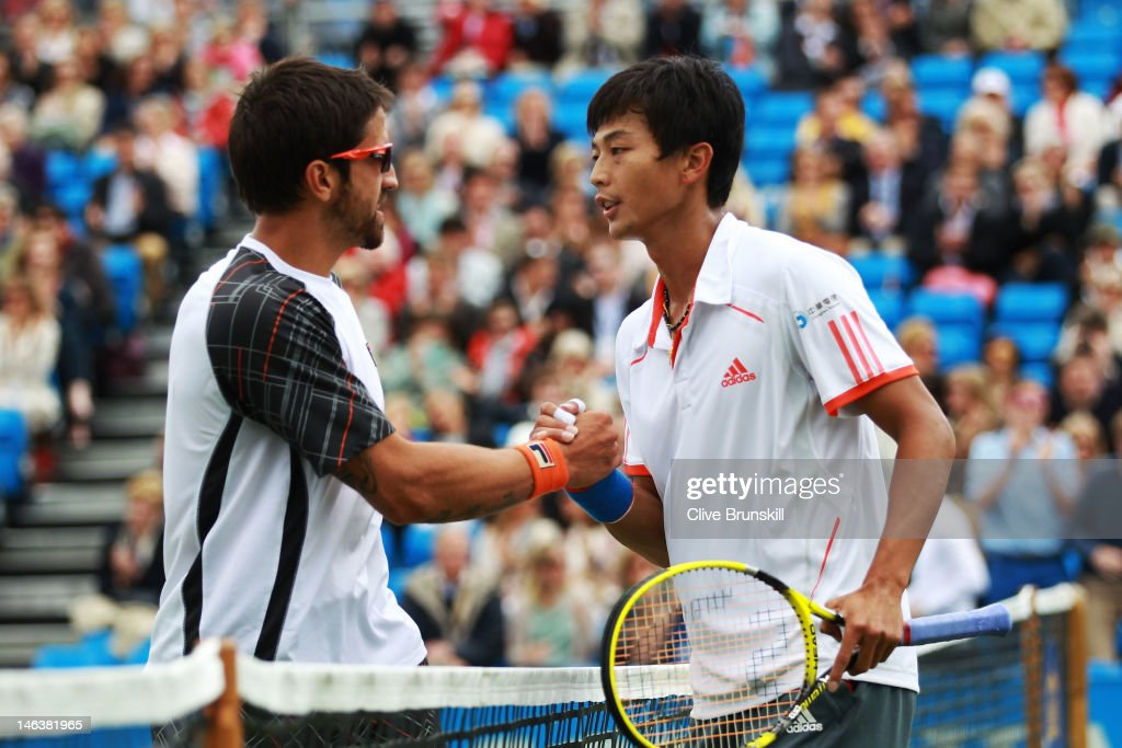 Janko Tipsarevic of Serbia (L) congratulated Yen-Hsun Lu of Taiwan after their mens singles third round match against on day five of the AEGON Championships at Queens Club on June 15, 2012 in London, England.