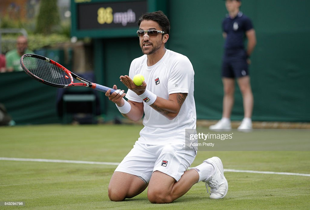<a gi-track='captionPersonalityLinkClicked' href=/galleries/search?phrase=Janko+Tipsarevic&family=editorial&specificpeople=546505 ng-click='$event.stopPropagation()'>Janko Tipsarevic</a> of Serbia looks on during the Men's Singles first round against Gilles Simon of France on day one of the Wimbledon Lawn Tennis Championships at the All England Lawn Tennis and Croquet Club on June 27th, 2016 in London, England.
