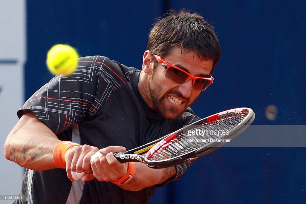 <a gi-track='captionPersonalityLinkClicked' href=/galleries/search?phrase=Janko+Tipsarevic&family=editorial&specificpeople=546505 ng-click='$event.stopPropagation()'>Janko Tipsarevic</a> of Serbia plays a back hand during his semi finale match against Thomaz Bellucci of Brazil during the Mercedes Cup 2012 at the TC Weissenhof on July 14, 2012 in Stuttgart, Germany.