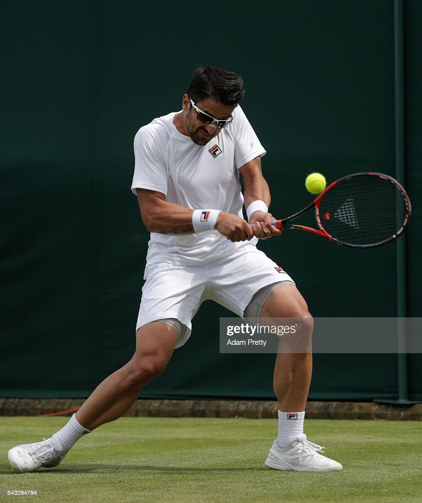 <a gi-track='captionPersonalityLinkClicked' href=/galleries/search?phrase=Janko+Tipsarevic&family=editorial&specificpeople=546505 ng-click='$event.stopPropagation()'>Janko Tipsarevic</a> of Serbia plays a backhand shot during the Men's Singles first round against Gilles Simon of France on day one of the Wimbledon Lawn Tennis Championships at the All England Lawn Tennis and Croquet Club on June 27th, 2016 in London, England.