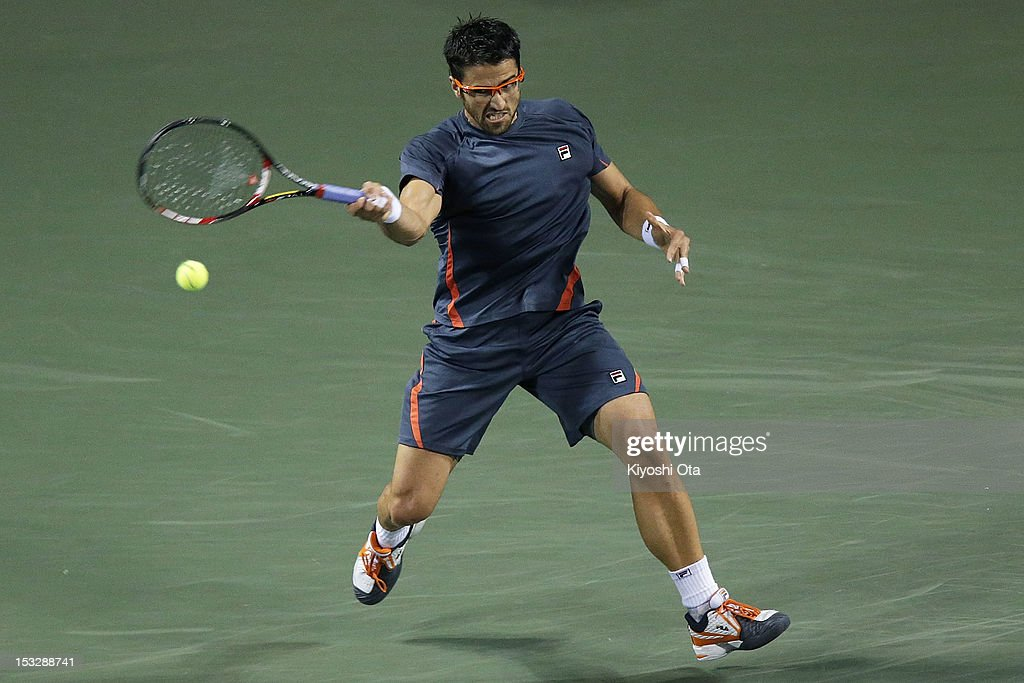 Janko Tipsarevic of Serbia plays a forehand in his first round match against Gilles Simon of France during day three of the Rakuten Open at Ariake Colosseum on October 3, 2012 in Tokyo, Japan.