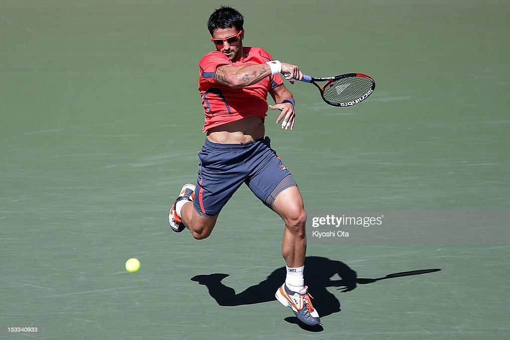 Janko Tipsarevic of Serbia plays a forehand in his second round match against Marco Chiudinelli of Switzerland during day four of the Rakuten Open at Ariake Colosseum on October 4, 2012 in Tokyo, Japan.