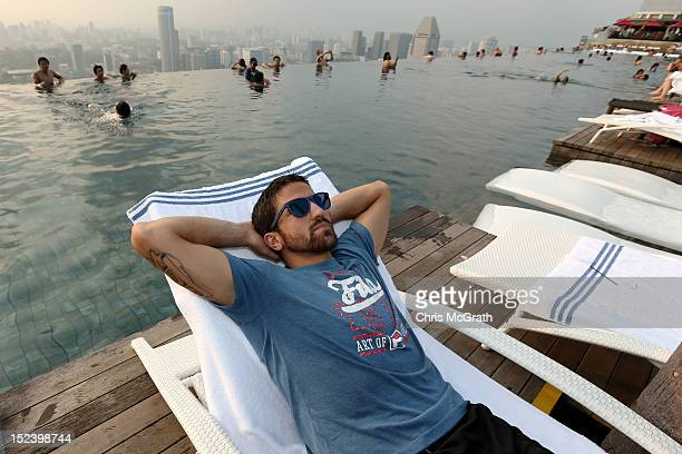 Janko Tipsarevic of Serbia poses for a portrait at the Infinity Pool at Marina Bay Sands during the ATP World Tour Asian Tour on September 20 2012 in...