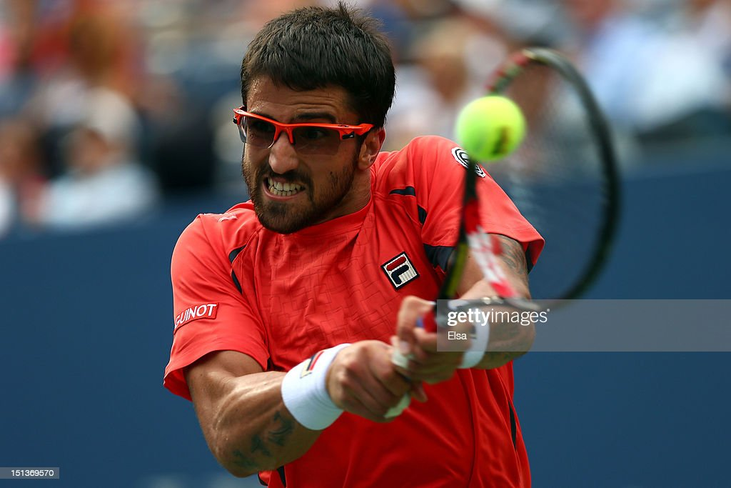 <a gi-track='captionPersonalityLinkClicked' href=/galleries/search?phrase=Janko+Tipsarevic&family=editorial&specificpeople=546505 ng-click='$event.stopPropagation()'>Janko Tipsarevic</a> of Serbia returns a shot against David Ferrer of Spain during their men's singles quarterfinal match on Day Eleven of the 2012 US Open at USTA Billie Jean King National Tennis Center on September 6, 2012 in the Flushing neighborhood of the Queens borough of New York City.