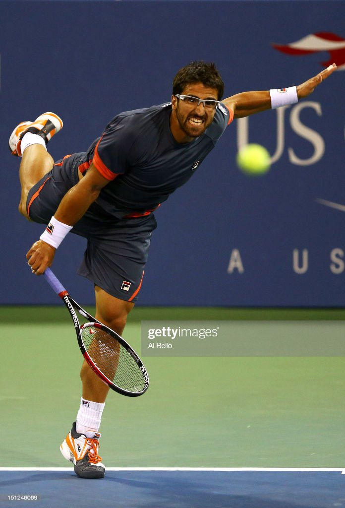 Janko Tipsarevic of Serbia serves during his men's singles fourth round match against Philipp Kohlschreiber of Germany on Day Nine of the 2012 US Open at USTA Billie Jean King National Tennis Center on September 4, 2012 in the Flushing neighborhood of the Queens borough of New York City.
