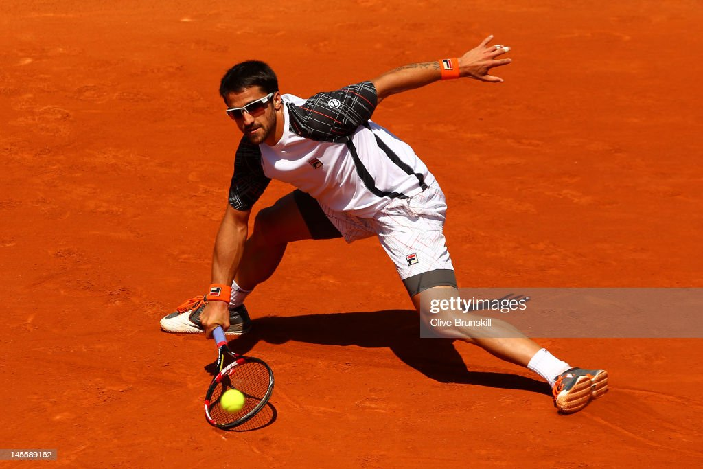 Janko Tipsarevic of Serbia slides across the clay to play a forehand during his men's singles third round match against Julien Benneteau of France during day seven of the French Open at Roland Garros on June 2, 2012 in Paris, France.