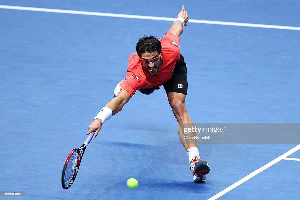 Janko Tipsarevic of Serbia stretches to hit a forehand during the men's singles match against Roger Federer of Switzerland on day two of the ATP World Tour Finals at the O2 Arena on November 6, 2012 in London, England.