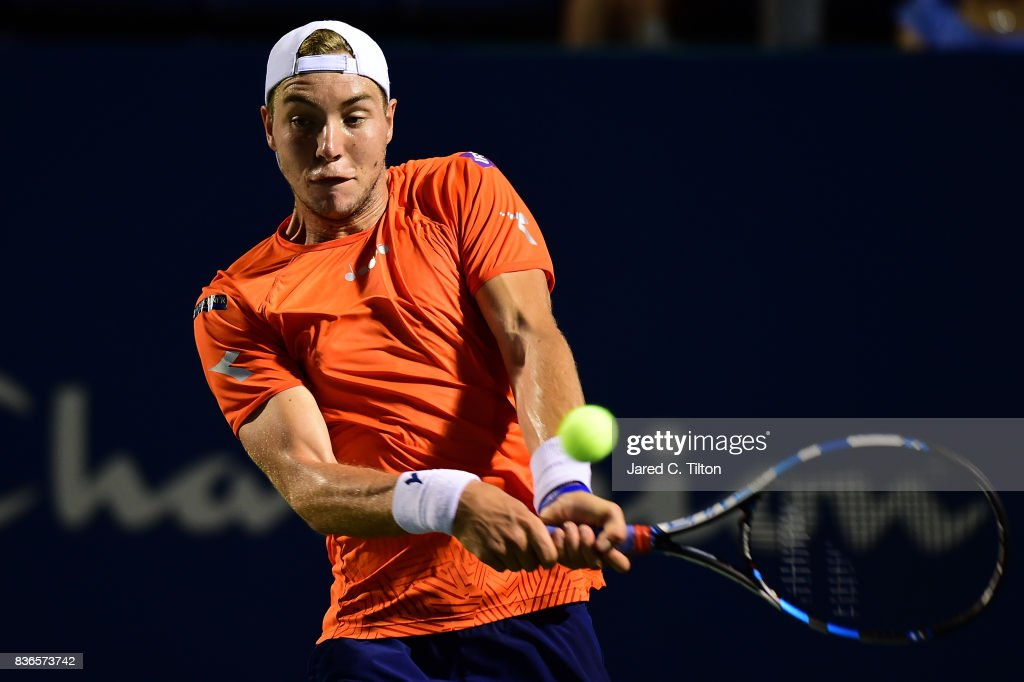 Jan-Lennard Struff of Germany returns a shot from Pablo Cuevas of Uruguay during the third day of the Winston-Salem Open at Wake Forest University on August 21, 2017 in Winston Salem, North Carolina.