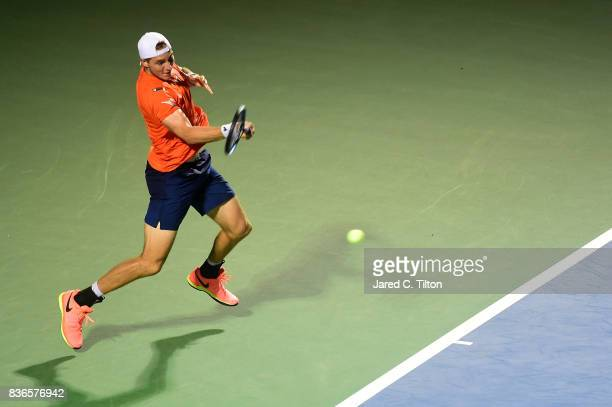JanLennard Struff of Germany returns a shot from Pablo Cuevas of Uruguay during the third day of the WinstonSalem Open at Wake Forest University on...