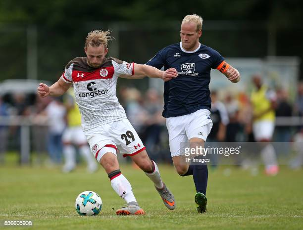JanMarc Schneider of St Pauli and Thorsten Toennies of Oldenburg battle for the ball during the preseason friendly match between VfB Oldenburg and FC...