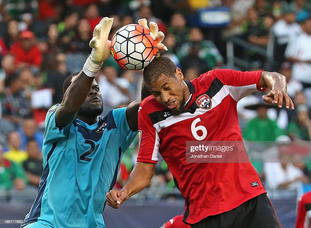JanMichael Williams of Trinidad Tobago makes a save off of the head of teammate Radanfal Abu Bakr against Guatemala during a match in the 2015...