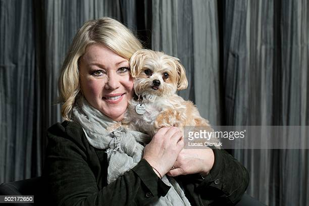 Jann Arden and her beloved dog Midi photographed at the Pantages Hotel in Toronto Midi is a Morkie a Maltese and Yokrshire cross