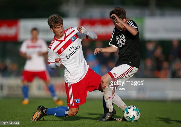 Jann Fiete Arp of Hamburg and Michel Mueller of Rotenburg battle for the balll during the preseason friendly match between Rotenburger SV and...