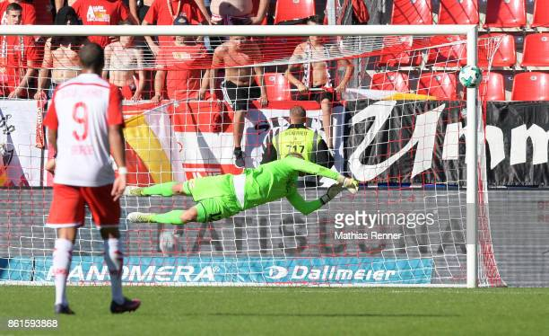 Jann George of SSV Jahn Regensburg and Jakob Busk of 1 FC Union Berlin during the game between Jahn Regensburg and Union Berlin on october 15 2017 in...