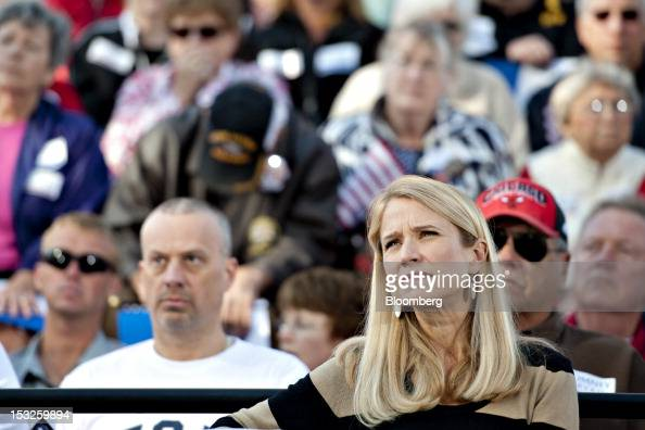 Janna Ryan wife of Representative Paul Ryan Republican vice presidential candidate listens to her husband speak during a campaign stop outside the...