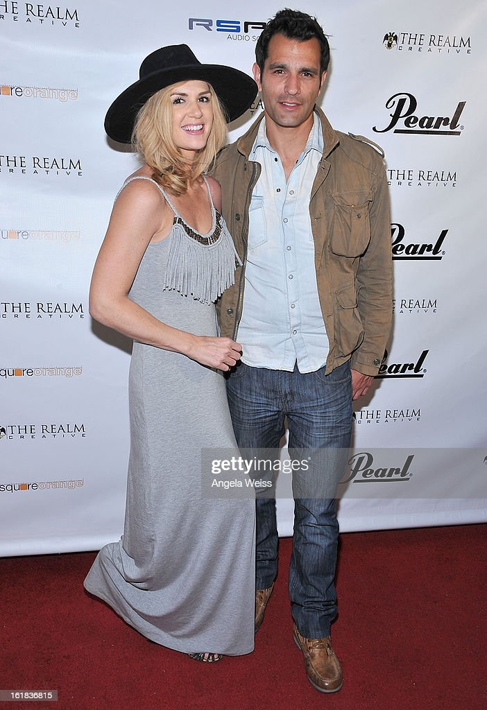 Janna Williams and Dave Baez attend The Realm Creative red carpet premier party on February 16, 2013 in Los Angeles, California.