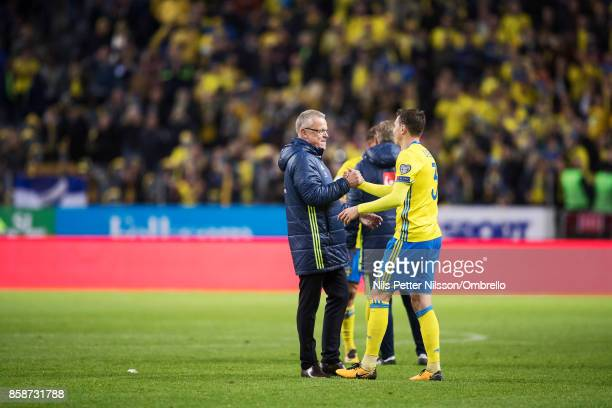 Janne Andersson head coach of Sweden and Victor Lindelof of Sweden celebrates after the victory during the FIFA 2018 World Cup Qualifier between...