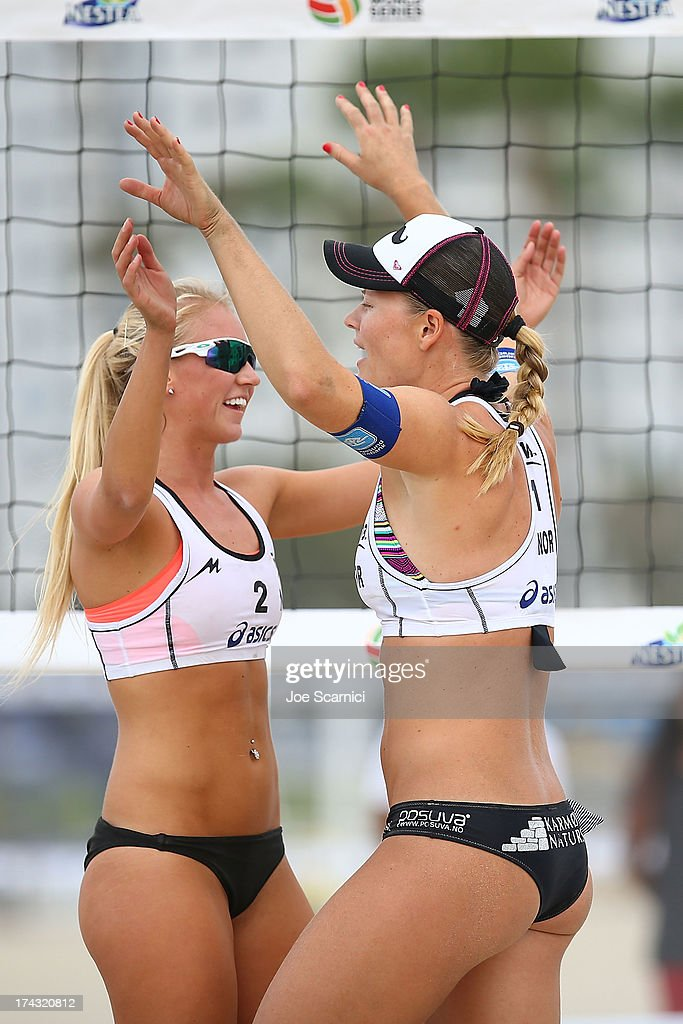 Janne Kongsavn (L) of Norway celebrates with teammate Victoria Kjolberg at the ASICS World Series of Beach Volleyball - Day 2 on July 23, 2013 in Long Beach, California.