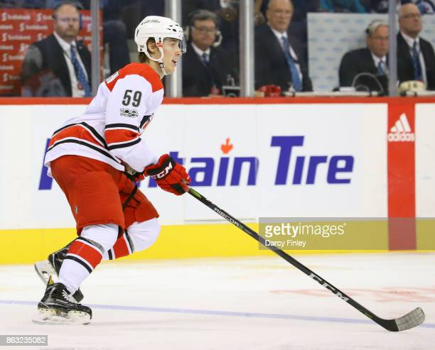 Janne Kuokkanen of the Carolina Hurricanes follows the play up the ice during third period action against the Winnipeg Jets at the Bell MTS Place on...