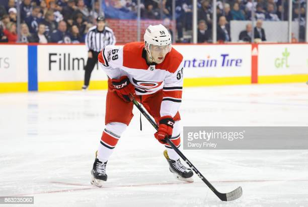Janne Kuokkanen of the Carolina Hurricanes gets set for a third period faceoff against the Winnipeg Jets at the Bell MTS Place on October 14 2017 in...