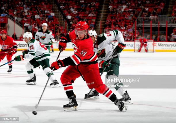 Janne Kuokkanen of the Carolina Hurricanes shoots the puck during an NHL game against the Minnesota Wild on October 7 2017 at PNC Arena in Raleigh...