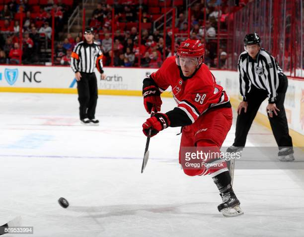 Janne Kuokkanen of the Carolina Hurricanes shoots the puck during an NHL game against the Anaheim Ducks on October 29 2017 at PNC Arena in Raleigh...