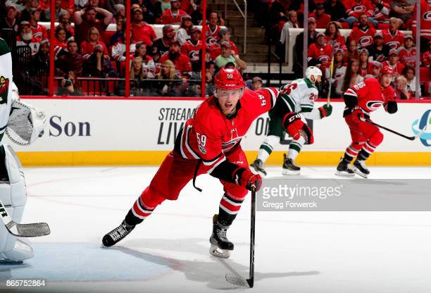 Janne Kuokkanen of the Carolina Hurricanes skates for position on the ice against the Minnesota Wild during an NHL game on October 7 2017 at PNC...