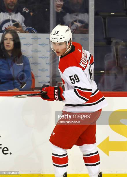 Janne Kuokkanen of the Carolina Hurricanes takes part in the pregame warm up prior to NHL action against the Winnipeg Jets at the Bell MTS Place on...