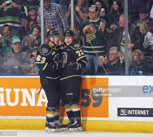 Janne Kuokkanen of the London Knights celebrates a goal with teammate Cliff Pu against the Windsor Spitfires during an OHL game at Budweiser Gardens...