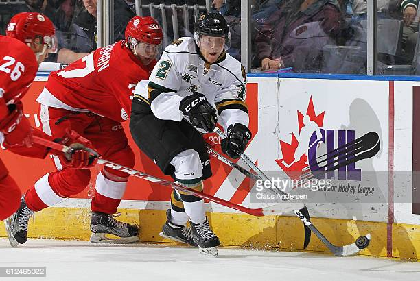 Janne Kuokkanen of the London Knights flips the puck forward against the Sault Ste Marie Greyhounds in an OHL game on Sept 30 2016 at Budweiser...