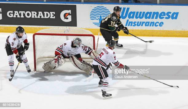 Janne Kuokkanen of the London Knights looks to make a pass against the Guelph Storm during an OHL game at Budweiser Gardens on March 9 2017 in London...