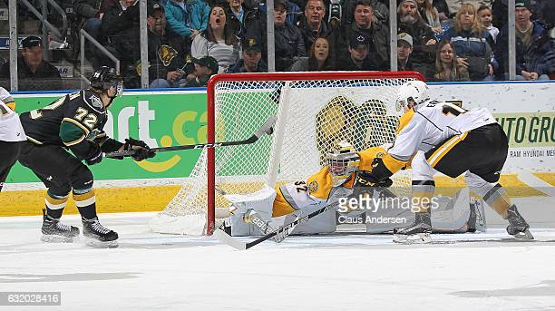 Janne Kuokkanen of the London Knights scores against Justin Fazio of the Sarnia Sting during an OHL game at Budweiser Gardens on January 18 2017 in...