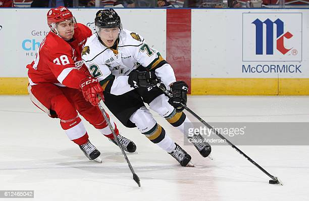 Janne Kuokkanen of the London Knights skates with the puck against Hayden Verbeek of the Sault Ste Marie Greyhounds during an OHL game on Sept 30...