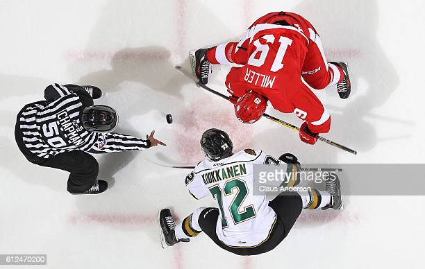 Janne Kuokkanen of the London Knights takes a faceoff against David Miller of the Sault Ste Marie Greyhounds during an OHL game on Sept 30 2016 at...