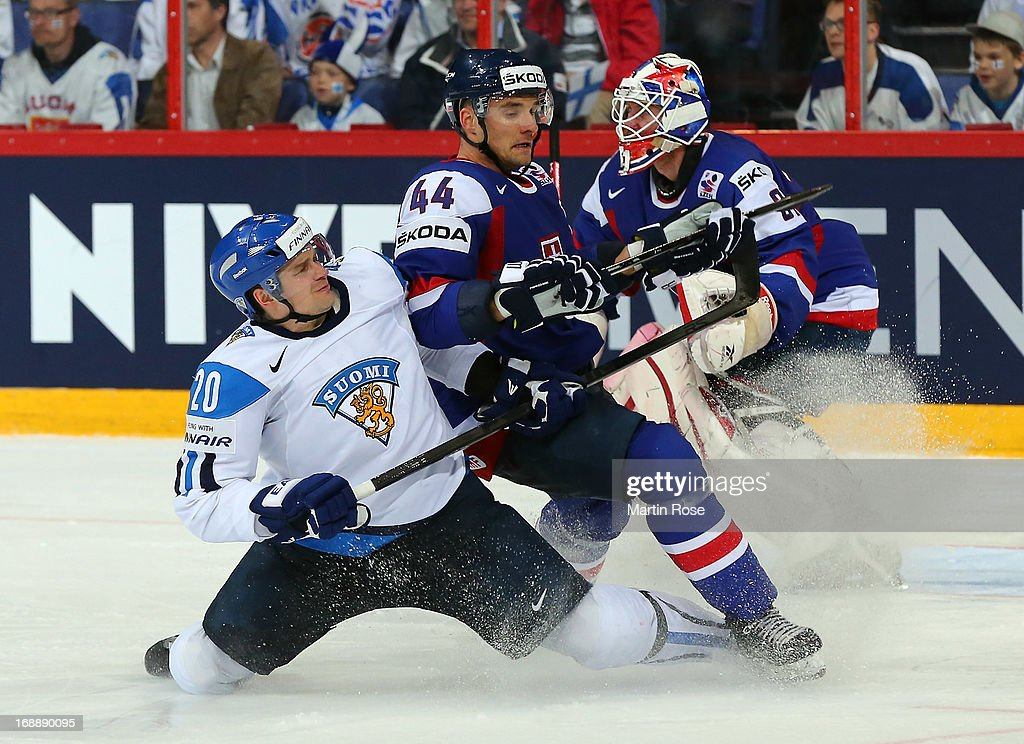 Janne Pesonen (L) of Finland and Andrej Sekera (R) of Slovakia battle for the puck during the IIHF World Championship quarterfinal match between Finland and Slovakia at Hartwall Areena on May 16, 2013 in Helsinki, Finland.