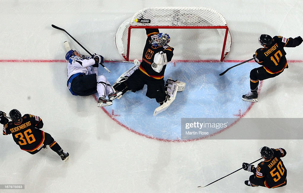 Janne Pesonen (#20) of Finland fails to score over <a gi-track='captionPersonalityLinkClicked' href=/galleries/search?phrase=Rob+Zepp&family=editorial&specificpeople=3121630 ng-click='$event.stopPropagation()'>Rob Zepp</a> (C), goaltender of Germany during the IIHF World Championship group H match between Finland and Germany at Hartwall Areena on May 3, 2013 in Helsinki, Finland.