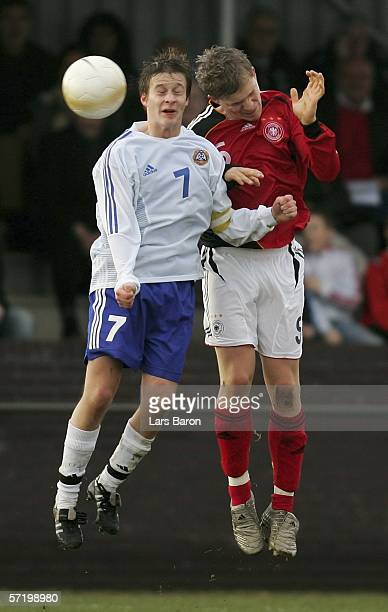 Janne Tormanen of Finland goes up for a header with Florian Jungwirth of Germany during the Men's Under 17 European Championship qualifier match...