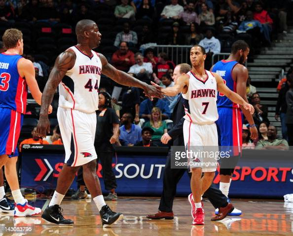 Jannero Pargo of the Atlanta Hawks is congratulated by teammate Ivan Johnson during a game against the Detroit Pistons on April 18 2012 at Philips...