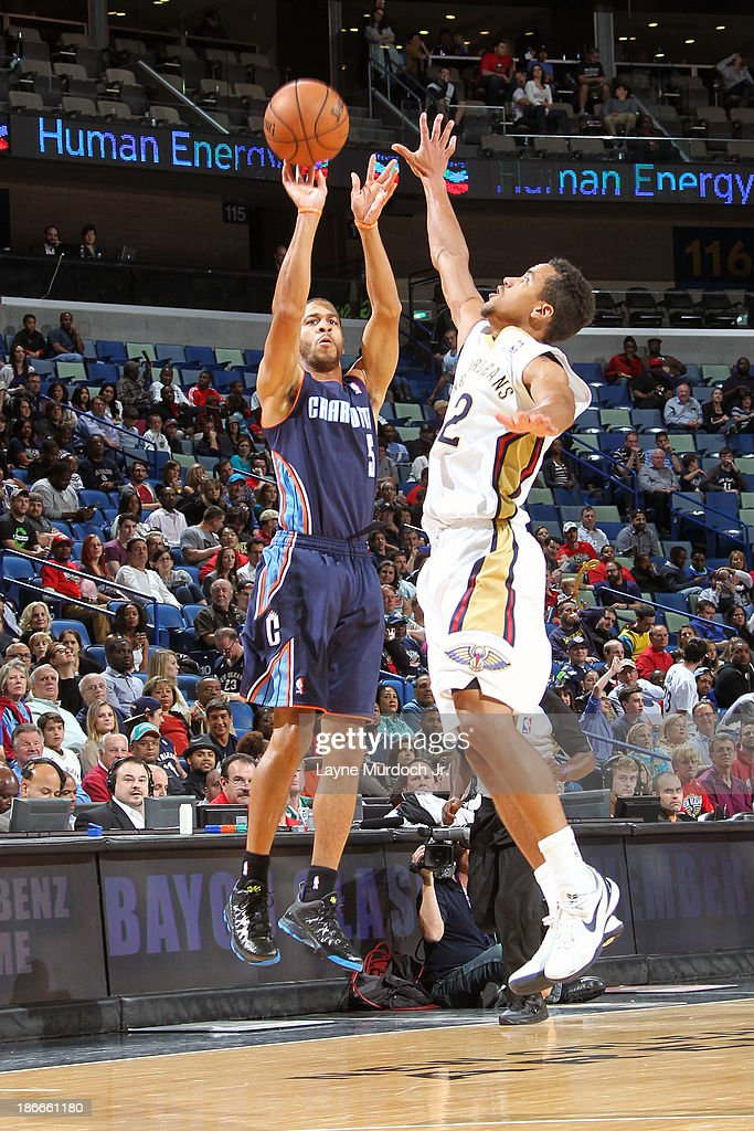 Jannero Pargo #5 of the Charlotte Bobcats shoots against Brian Roberts #22 of the New Orleans Pelicans on November 2, 2013 at the New Orleans Arena in New Orleans, Louisiana.