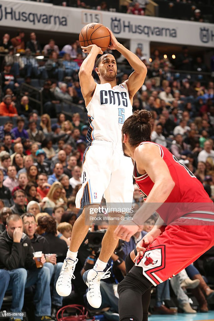 <a gi-track='captionPersonalityLinkClicked' href=/galleries/search?phrase=Jannero+Pargo&family=editorial&specificpeople=206618 ng-click='$event.stopPropagation()'>Jannero Pargo</a> #5 of the Charlotte Bobcats shoots against the Chicago Bulls at the Time Warner Cable Arena on January 25, 2014 in Charlotte, North Carolina.