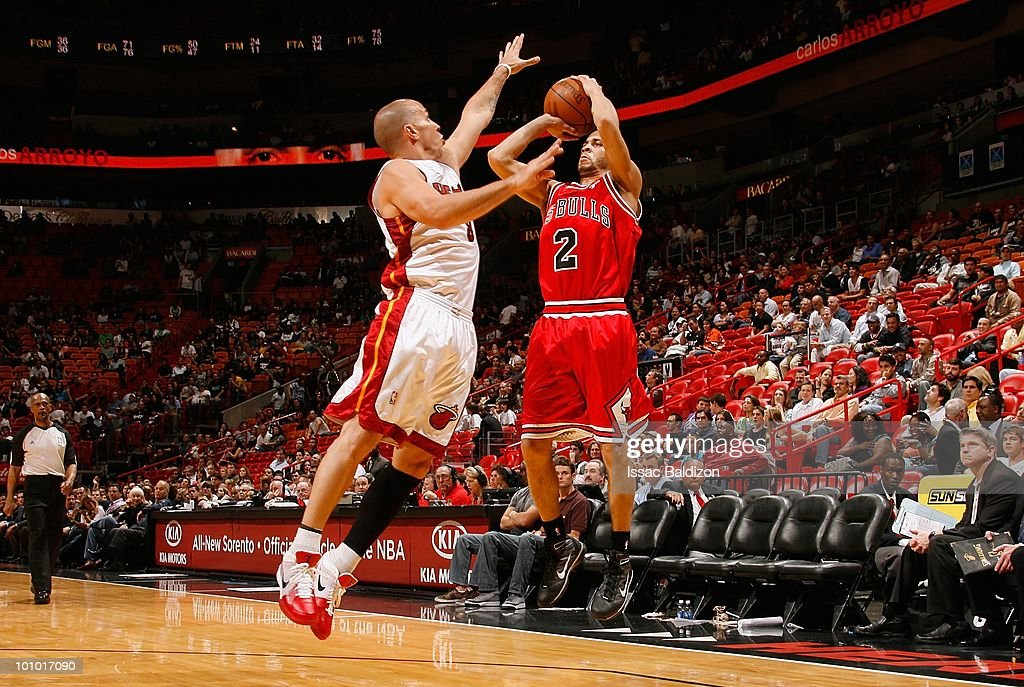 Jannero Pargo #2 of the Chicago Bulls takes a jump shot against Carlos Arroyo #8 of the Miami Heat during the game on March 12, 2010 at American Airlines Arena in Miami, Florida. The Heat won 108-95.