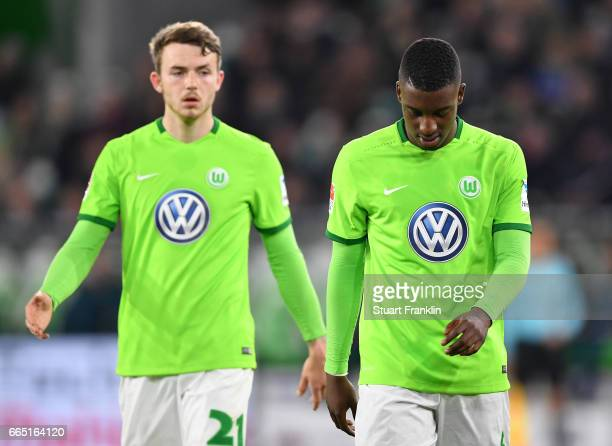 Jannes Horn and Riechedly Bazoer of Wolfsburg look dejected during the Bundesliga match between VfL Wolfsburg and SC Freiburg at Volkswagen Arena on...